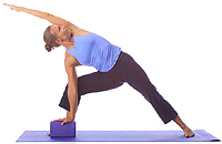 yoga beginner side angle stretch with block